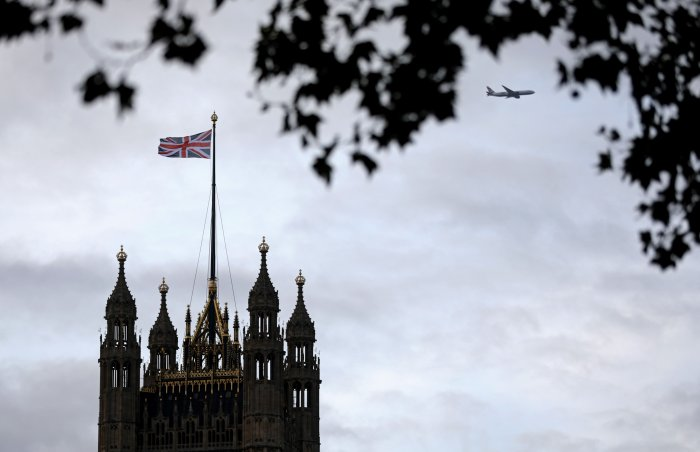 A Union flag flies from a pole atop the Victoria Tower at the Houses of Parliament in London on October 9, 2019. (Credit: AFP)