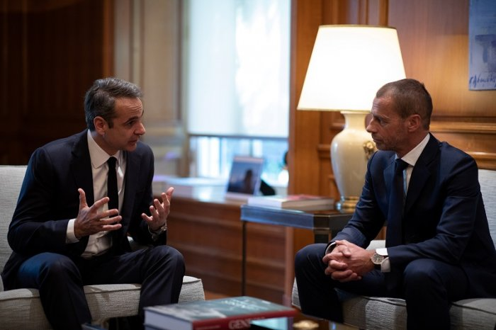 Greek Prime Minister Kyriakos Mitsotakis meets with UEFA President Aleksander Ceferin and FIFA vice-president Greg Clarke (not pictured) in his office at the Maximos Mansion in Athens, Greece. (Reuters Photo)