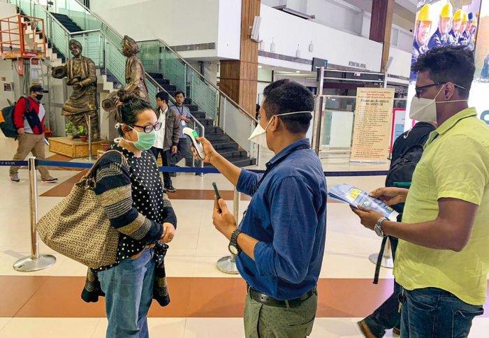 Passengers undergo a thermal screening test in the wake of novel coronavirus scare at Lokpriya Gopinath Bordoloi International Airport in Guwahati. PTI