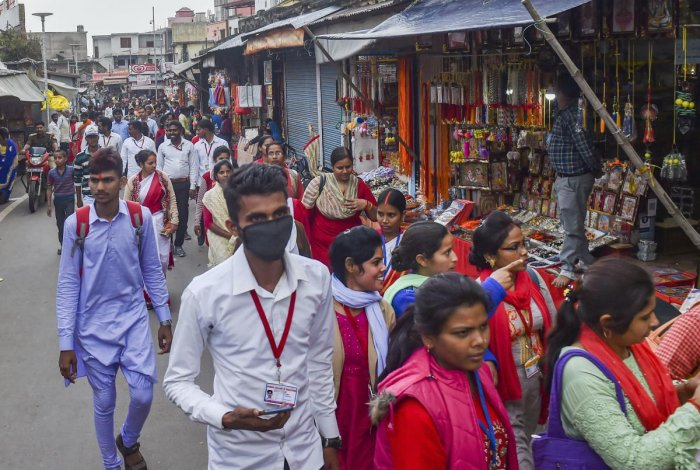A man wearing protective mask in the wake of coronavirus pandemic walks along Ramlala market in Ayodhya, Saturday, March 14, 2020. (PTI Photo)