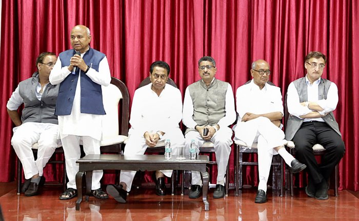 Madhya Pradesh Minister for Parliamentary Affairs Govind Singh addresses Congress legislature party meeting at CM's residence in Bhopal on Tuesday. Madhya Pradesh Chief Minister Kamal Nath senior Congress leader Digvijay Singh were also present on the occasion. (Credit: PTI Photo)
