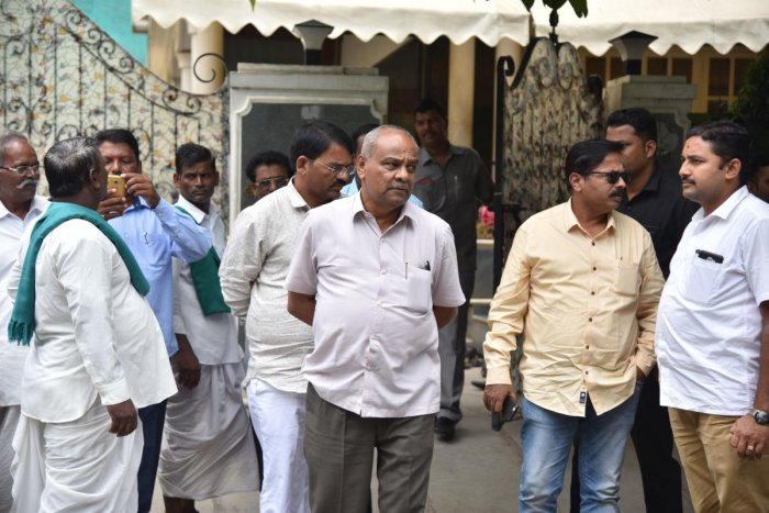 Former Minister Umesh Katti and supporters coming out BJP State President BS Yeddyurappa's house at Davalagiri, RMV 2nd stage in Bengaluru on Thursday, 25 July, 2019. Photo by Janardhan B K   DH Photo