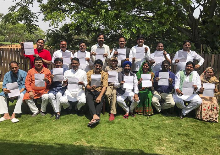 MLAs of the ruling Congress in Madhya Pradesh show their resignation letter as they pose for a group photo, in Bengaluru, Tuesday, March 10, 2020. (PTI Photo)