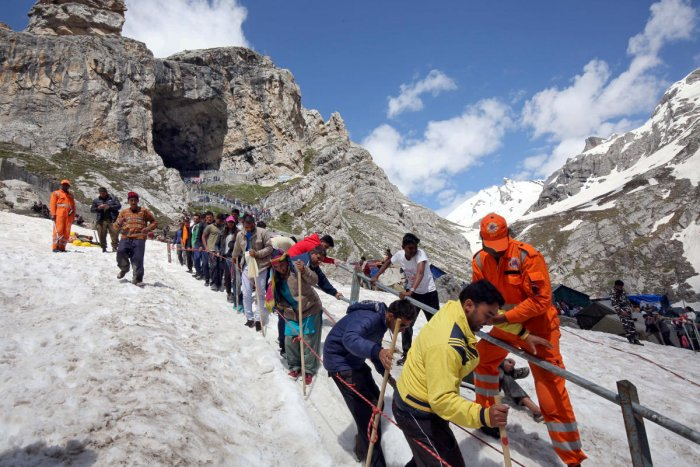 Hindu pilgrims leave the holy cave of Lord Shiva after worshipping in Amarnath. Credit: Reuters File Photo