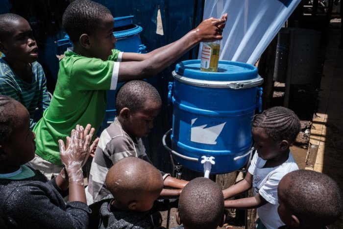 Children learn how to wash hands for prevention of the COVID-19 as local NGO Shining Hope for Communities (SHOFCO) installs hand washing stations at Kibera slum in Nairobi. Credit: AFP Photo