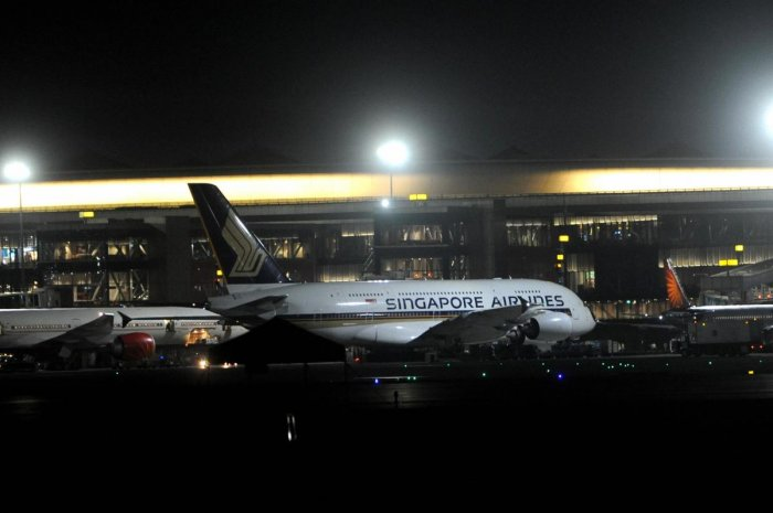 Singapore Airlines carrying Indian nationals in the wake of the coronavirus pandemic stands parked on arrival at Mumbai International Airport, Thursday night, March 19, 2020. (PTI Photo)
