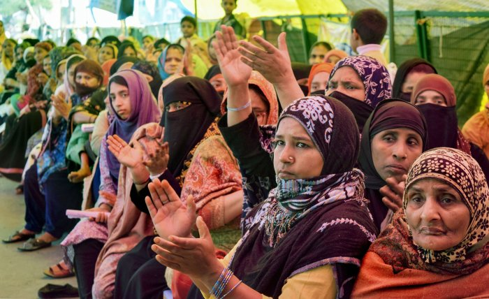 Women during a sit-in demonstration against CAA and NRC on International Women's Day at Shaheen Bagh in New Delhi. (PTI Photo)