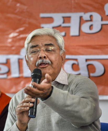 Vishva Hindu Parishad (VHP) President Alok Kumar addresses a press conference in New Delhi. (Credit: PTI)