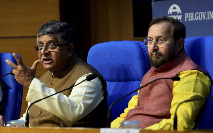 Union Ministers Prakash Javadekar (R) and Ravi Shankar Prasad during a press conference after the cabinet meeting, in New Delhi. (PTI Photo)