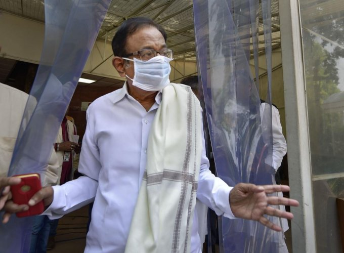 Senior Congress leader P Chidambaram wears a mask at Parliament, during the ongoing Budget Session, in New Delhi, Thursday, March 19, 2020. (PTI Photo)