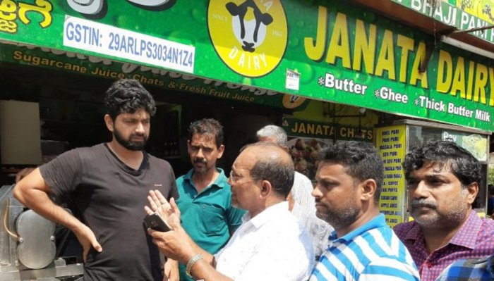 Office-bearers of Central Market Merchants' Association create awareness on cleanliness at Central Market in Mangaluru.