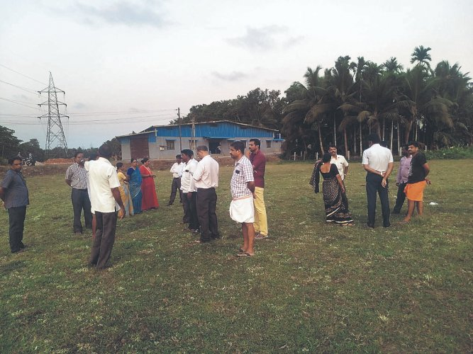 """As a part of the golden jubilee celebrations, we decided to involve students from class 8, 9, 10, their parents and old students in this farming initiative,"""" said the headmaster. (Credit: DH Photo)"""