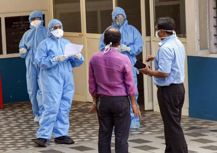 : Medics wearing protective suits interact with each other outside an isolation ward, set up in view of coronavirus pandemic, at Aluva Government General Hospital in Kochi, (PTI Photo)