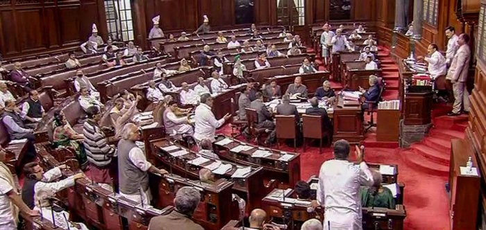 Opposition members protest in the Rajya Sabha during the Budget Session of Parliament, in New Delhi, Wednesday, March 18, 2020. (PTI Photo)