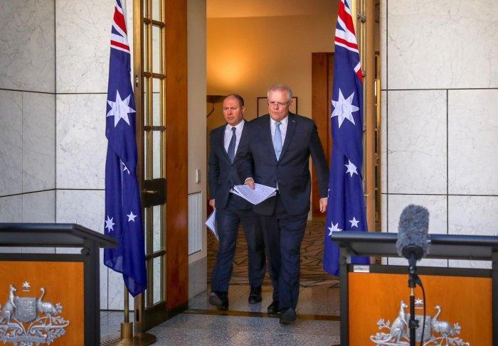 Australian Prime Minister Scott Morrison (R) and Australian Treasurer Josh Frydenberg arrives at a press conference at Australia's Parliament House in Canberra. AFP