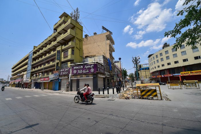 A city street wears a deserted look during 'Janta curfew' in the wake of coronavirus pandemic, in Bengaluru. (PTI Photo)