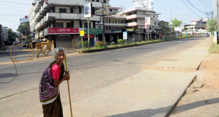 A lone senior citizen seen on the road in Manipal in Udupi on Sunday. DH Photo
