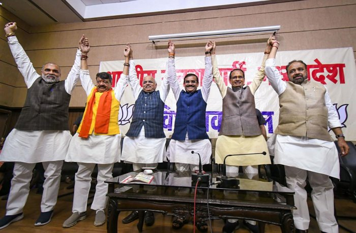 BJP leaders Shivraj Singh Chouhan (2R), VD Sharma, Gopal Bhargava, Vinay Sahasrabuddhe and Kailash Vijayvergiya and other celebrate during BJP legislative party meeting after Madhya Pradesh Chief Minister Kamal Nath resigned from his post, at state party headquarters in Bhopal, Friday, March 20, 2020. (PTI Photo)