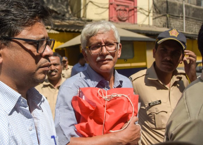 Vernon Gonsalves, one of the accused in the Bhima Koregaon violence case, is escorted by police to court for a hearing, in Mumbai. (PTI File Photo)