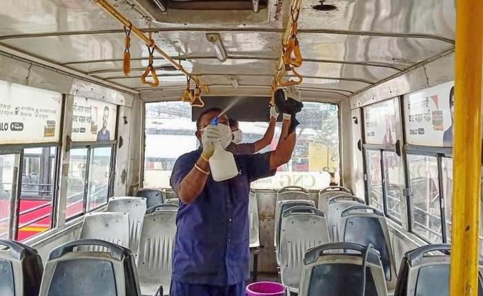 A health official sprays disinfectants inside a city bus in the wake of coronavirus pandemic, in Nagpur, Saturday, March 14, 2020. (PTI Photo)