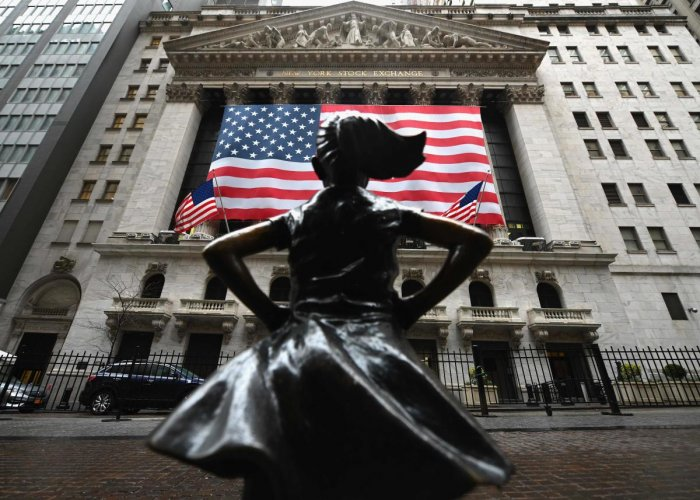 """Beaten-down US stocks opened solidly higher on March 24, 2020 on hopes that Washington lawmakers will agree on a massive stimulus package, while the G7 pledged to """"do whatever is necessary"""" to restore growth.About five minutes into trading, the Dow Jones Industrial Average was up 7.0 percent, or 1,300 points, at 19,890.77."""
