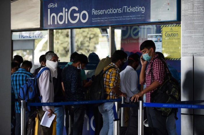 People lineup at a IndiGo Airlines ticket counter at the Sardar Vallabhbhai Patel Airport in Ahmedabad on March 23, 2020. Credit: AFP Photo