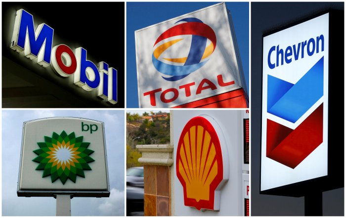 A combination of file photos shows the logos of five of the largest publicly traded oil companies; BP, Chevron, Exxon Mobil, Royal Dutch Shell, and Total. (Credit: Reuters)
