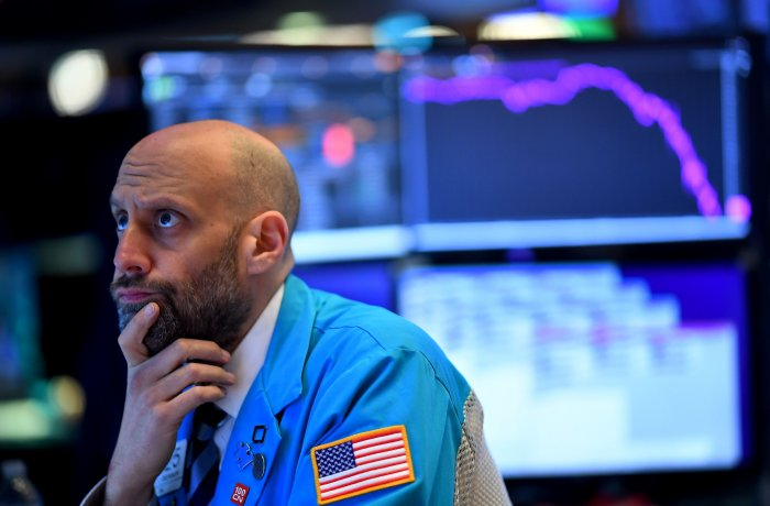 In this file photo traders work during the opening bell at the New York Stock Exchange (NYSE) on March 19, 2020, at Wall Street in New York City. (Credit: AFP Photo)