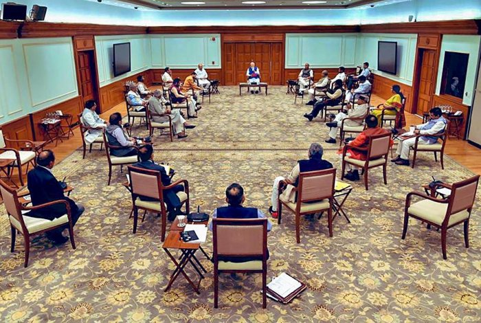 Prime Minister Narendra Modi chairs a cabinet meeting as ministers maintain social distancing in the wake of coronavirus pandemic. (PTI Photo)
