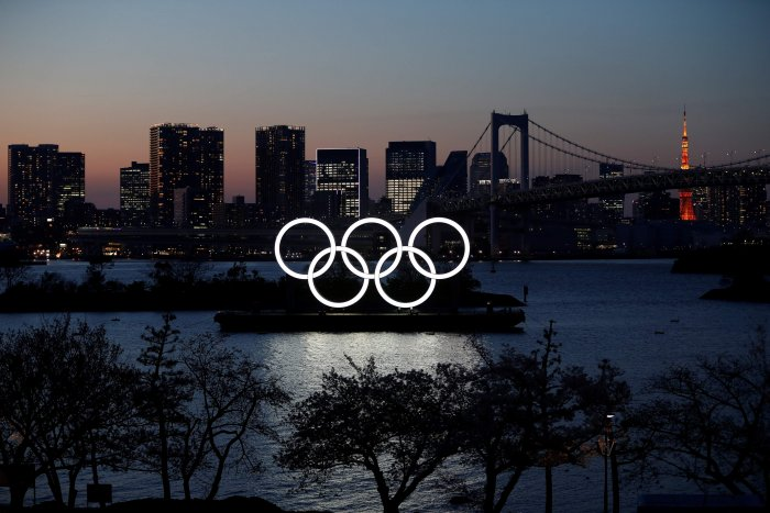 The giant Olympic rings are seen through at the waterfront area at Odaiba Marine Park. (Credit: Reuters)