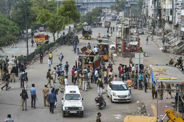 Police load in a truck the items seized from the anti-CAA protest site, at Jamia nagar in New Delhi, Tuesday, March 24, 2020. (Credit: PTI Photo)