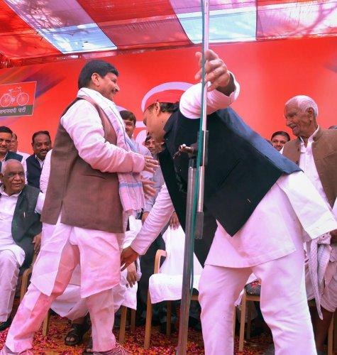 SP leader Akhilesh Yadav seeks blessings from Pragatisheel Samajwadi Party leader Shivpal Singh Yadav during an event to celebrate Holi festival, in Etawah, on March 10, 2020. PTI