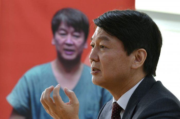 South Korean multi-millionaire and former presidential candidate Ahn Cheol-soo is also a doctor and spent 15 days on the coronavirus front line, treating intensive care patients in Daegu, the centre of his country's epidemic. (Credit: AFP)