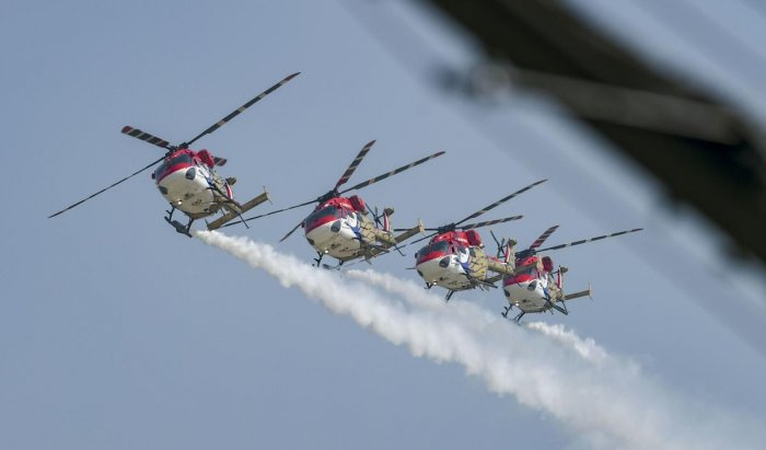 Indian Air Force's Sarang helicopters perform aerobatic stunts during rehearsals for the 87th Indian Air Force Day celebrations at Hindon Airbase, Ghaziabad. (PTI photo)
