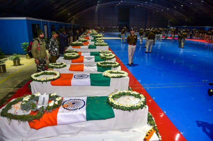 Mortal remains of CRPF jawans, who lost their lives in the Pulwama terror attack, during a tribute paying ceremony at AFS Palam in New Delhi. (PTI Photo)