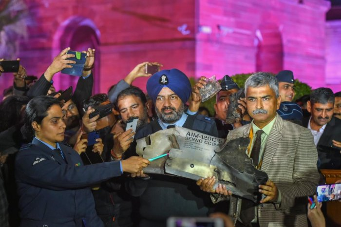 Indian Air Force officials show sections of an exploded Amraam missile, said to be fired by Pakistan Air Force (PAF) F-16s, at an IAF, Army and Navy joint press conference at South Block in New Delhi, on Thursday. PTI