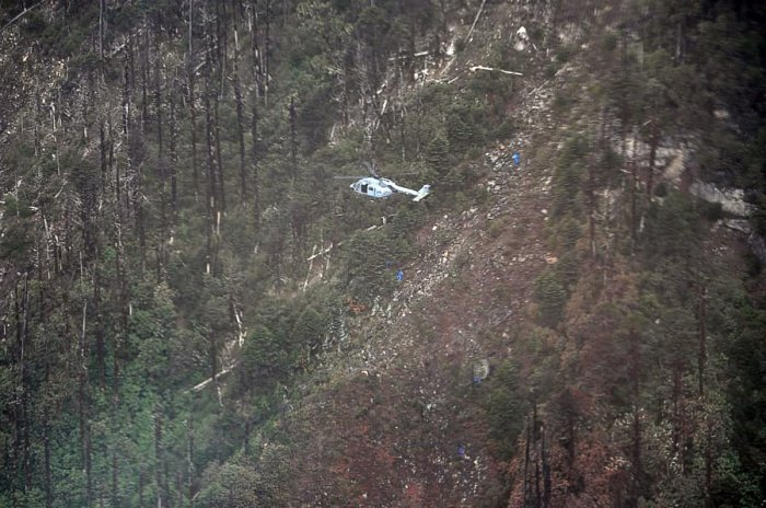 This handout photo released by the Indian Air Force (IAF) on June 14, 2019 shows an Advanced Light Helicopter (ALH) at the crash site of the IAF AN-32 aircraft, about 16 km north of Lipo in Arunachal Pradesh. (IAF/AFP)