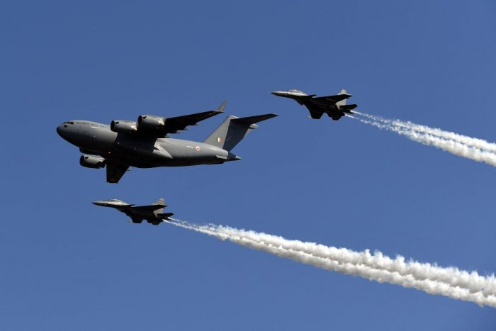 An Indian Air Force (IAF) cargo aircraft C-17 Globemaster (front) and Sukhoi fighter jets (back L and R) fly past during the Air Force Day parade at an IAF station in Ghaziabad, on the outskirts of New Delhi, on October 8, 2019. (AFP Photo)