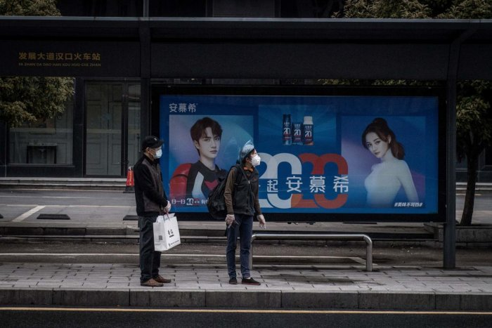 Residents wait at a bus station in Wuhan in China's central Hubei province on March 25, 2020, after the public transportation partly resumed in the city. Credit: AFP Photo