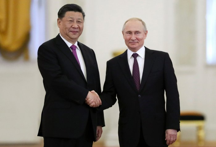 Russian President Vladimir Putin, right, and Chinese President Xi Jinping shake hands during their meeting in the Kremlin in Moscow, Russia. (PTI photo)