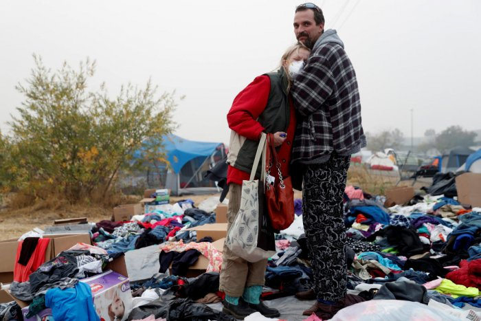 Travis Lee Hogan, of Paradise, comforts his mother, Bridgett Hogan, while they stay at a makeshift evacuation center for people displaced by the Camp Fire in Chico, California. Reuters Photo