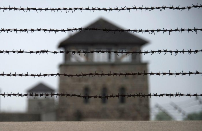 (FILES) In this file photo taken on April 28, 2015, a barbed wire fence is pictured at the former Nazi concentration camp Mauthausen, northern Austria. - German prosecutors on November 23, 2018 charged a 95-year-old man with more than 36,000 counts of acc
