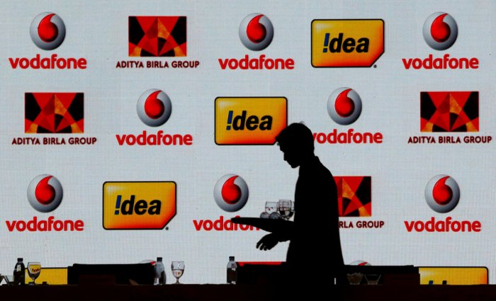 A hotel employee clears a table after Vodafone Group and Idea Cellular news conference in Mumbai, India on March 20, 2017. REUTERS/File Photo
