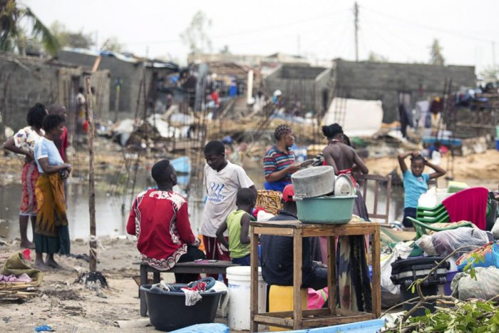 In this photo taken on Friday, March 15, 2019 and provided by the International Red Cross, People salvaging what is left of their belongings after Tropical Cyclone Idai, in Beira, Mozambique. Mozambique's President Filipe Nyusi says that more than 1,000 m