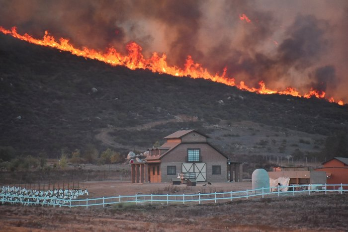 A fire burns in Valle de Guadalupe, Baja California, Mexico October 25, 2019 in this picture obtained from social media. (Reuters Photo)