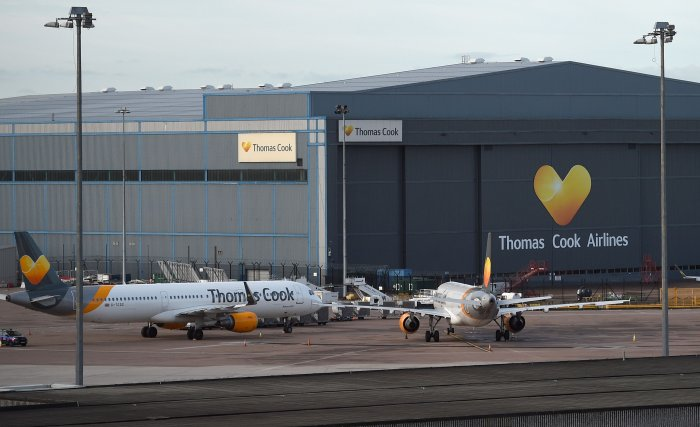 Thomas Cook passenger aircraft stand at on the tarmac outside the company's hangar at Manchester Airport in Manchester, northern England. (AFP Photo)