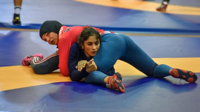 SLUGGING IT OUT Indian wrestlers Sakshi Malik (red) with Vinesh Phogat during a training session in Jakarta on Friday. PTI