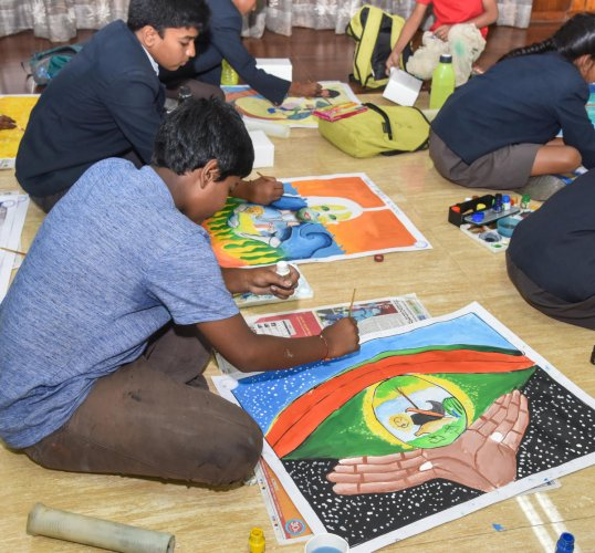 Schoolchildren take part in a drawing contest organised by the forest department on the first day of the 64th Wildlife Week in Bengaluru on Sunday. DH PHOTO/S K Dinesh