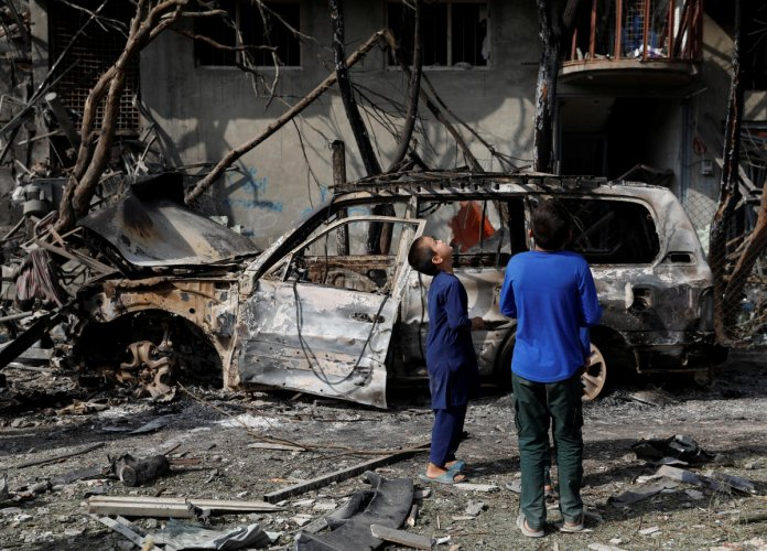Afghan boys look at the site of Sunday's attack in Kabul, Afghanistan (Reuters Photo)