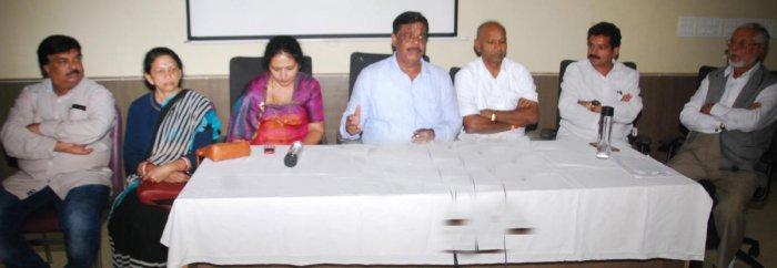 Former minister H C Mahadevappa addresses the media in Madikeri.